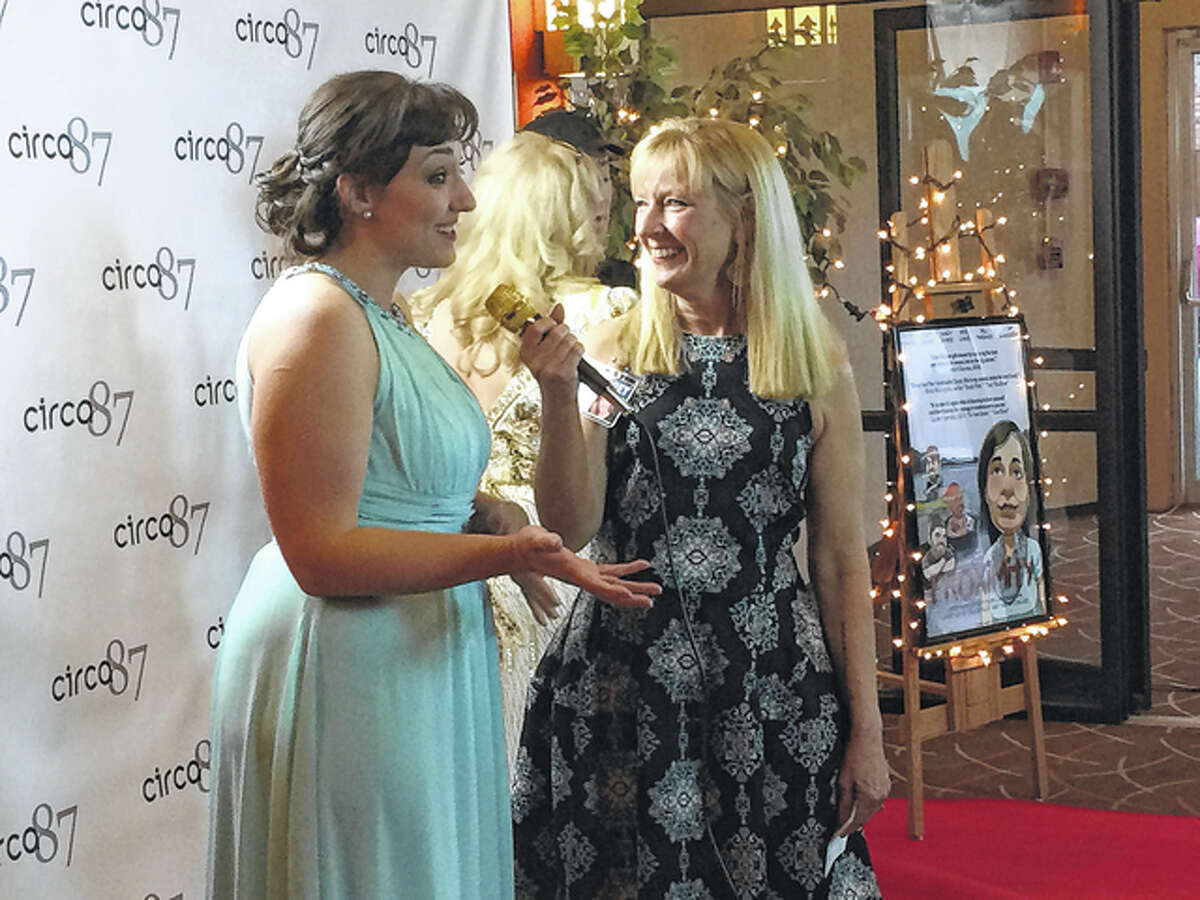 """Jackie Manker (left) speaks to the media Saturday on the red carpet at the screening of """"Proximity,"""" at the Illinois Theater in Jacksonville."""