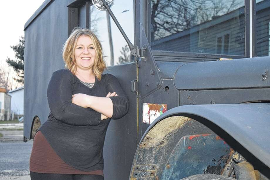 The Soap Co. Coffee House owner and operator Nicole Riley leans against her soon-to-be-launched coffee wagon.