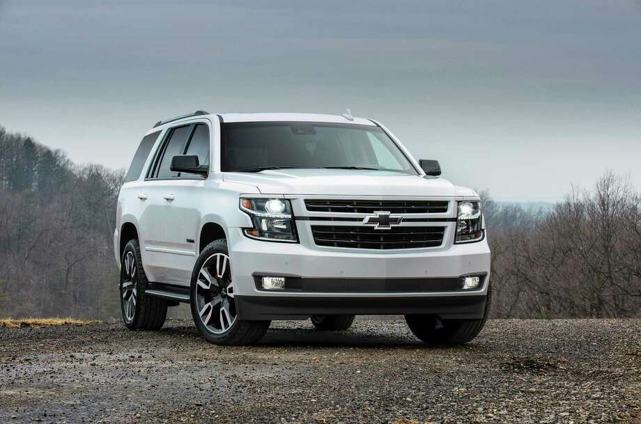 "You can spot a 2018 Tahoe RST Edition by the black ""bow tie"" emblem on its grille. High-intensity-discharge headlights are standard. Photo: Chevrolet"