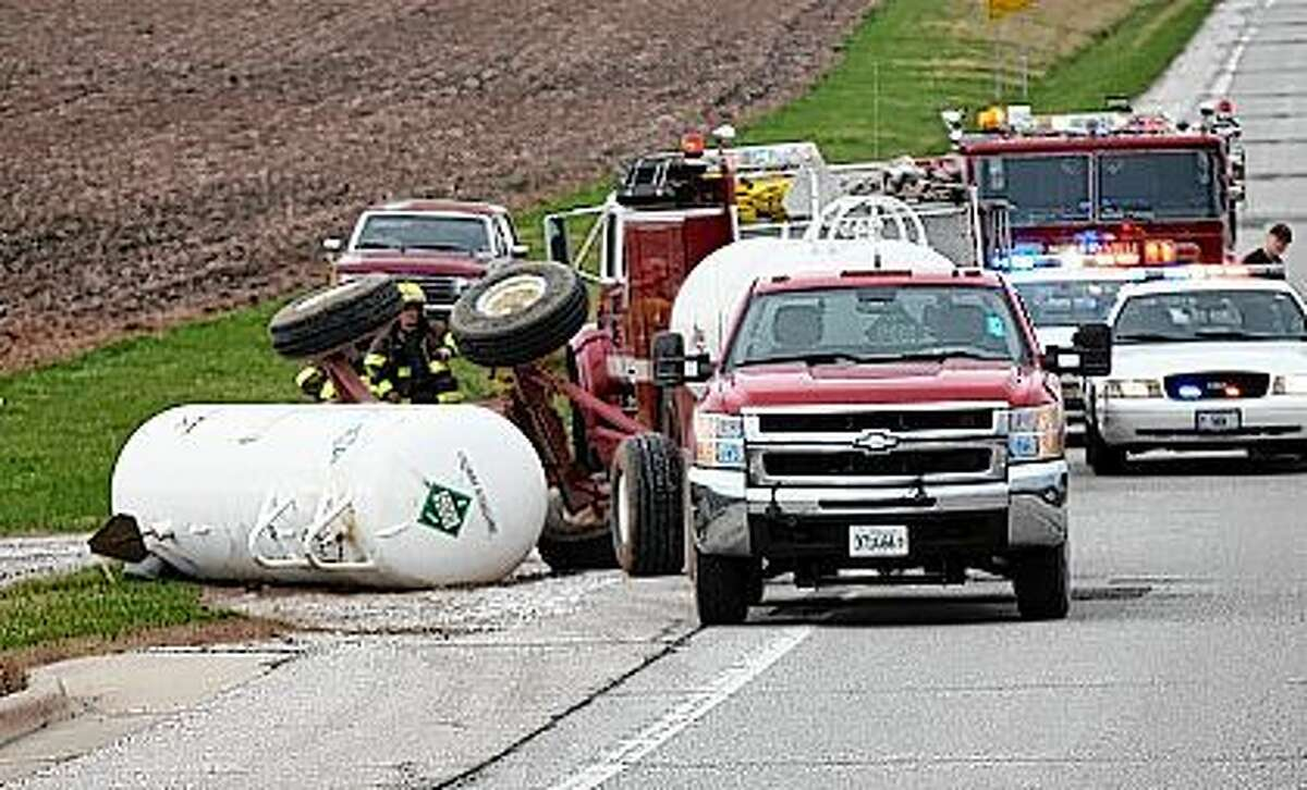 Police respond to an anhydrous ammonia tank that toppled just south of the Murrayville overpass on Illinois Route 267 Wednesday.