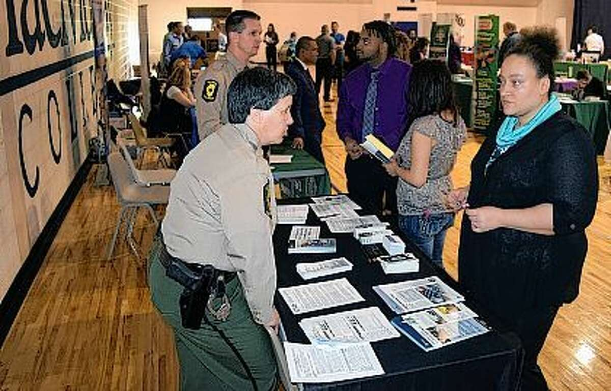 Illinois State Police Sgt. Linda Strubbe (left) talks Wednesday with MacMurray College junior Jasmine White of Jacksonville at the Jacksonville College and Community Career Fair at MacMurray. Nearly 50 businesses and three graduate schools provided information on internships and full-time jobs. The businesses represented such fields as health care, accounting, news media, hotel management and manufacturing. The career fair was co-sponsored by MacMurray College and Illinois College.