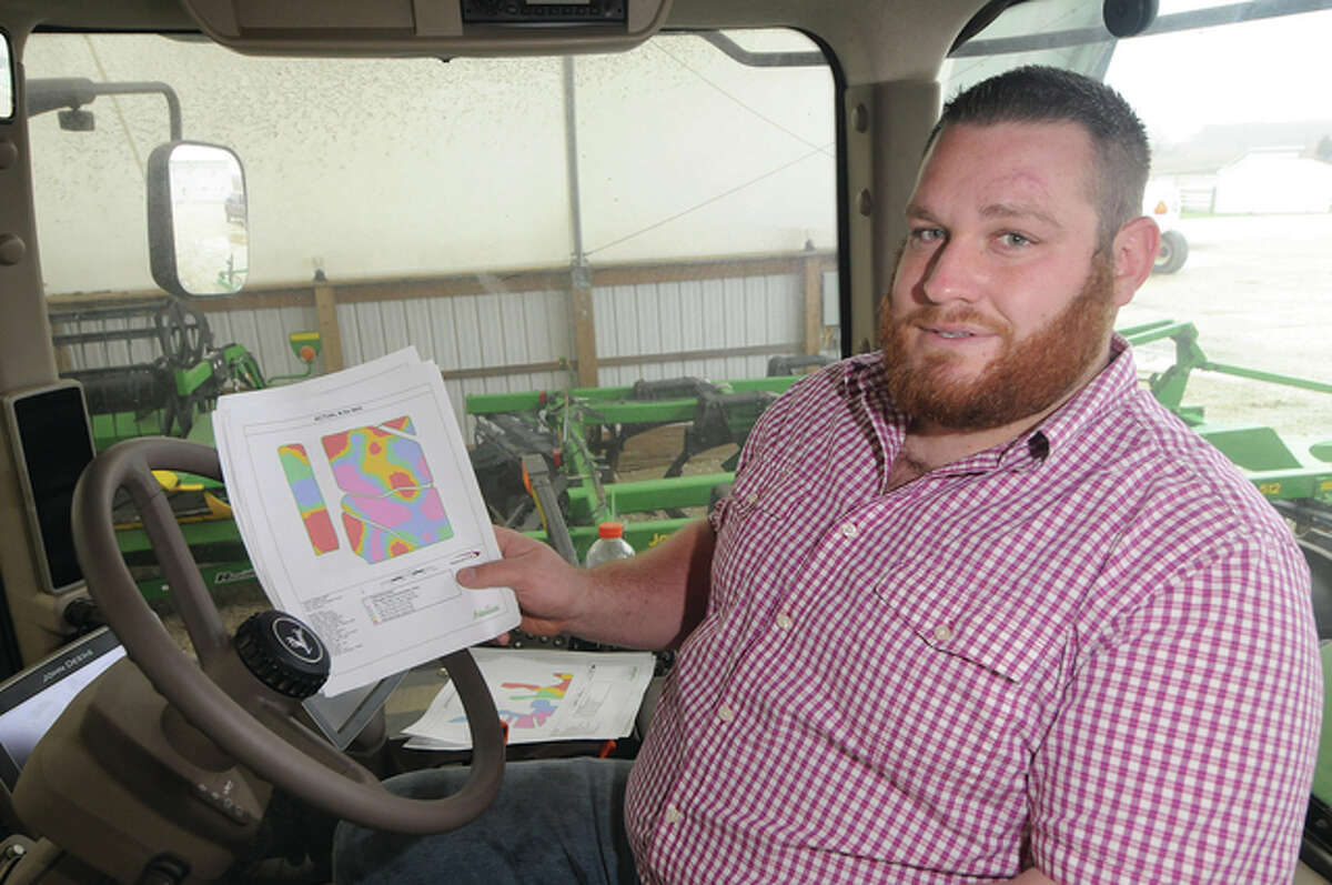 Cody Mason shows a detailed map used for farming on his land.