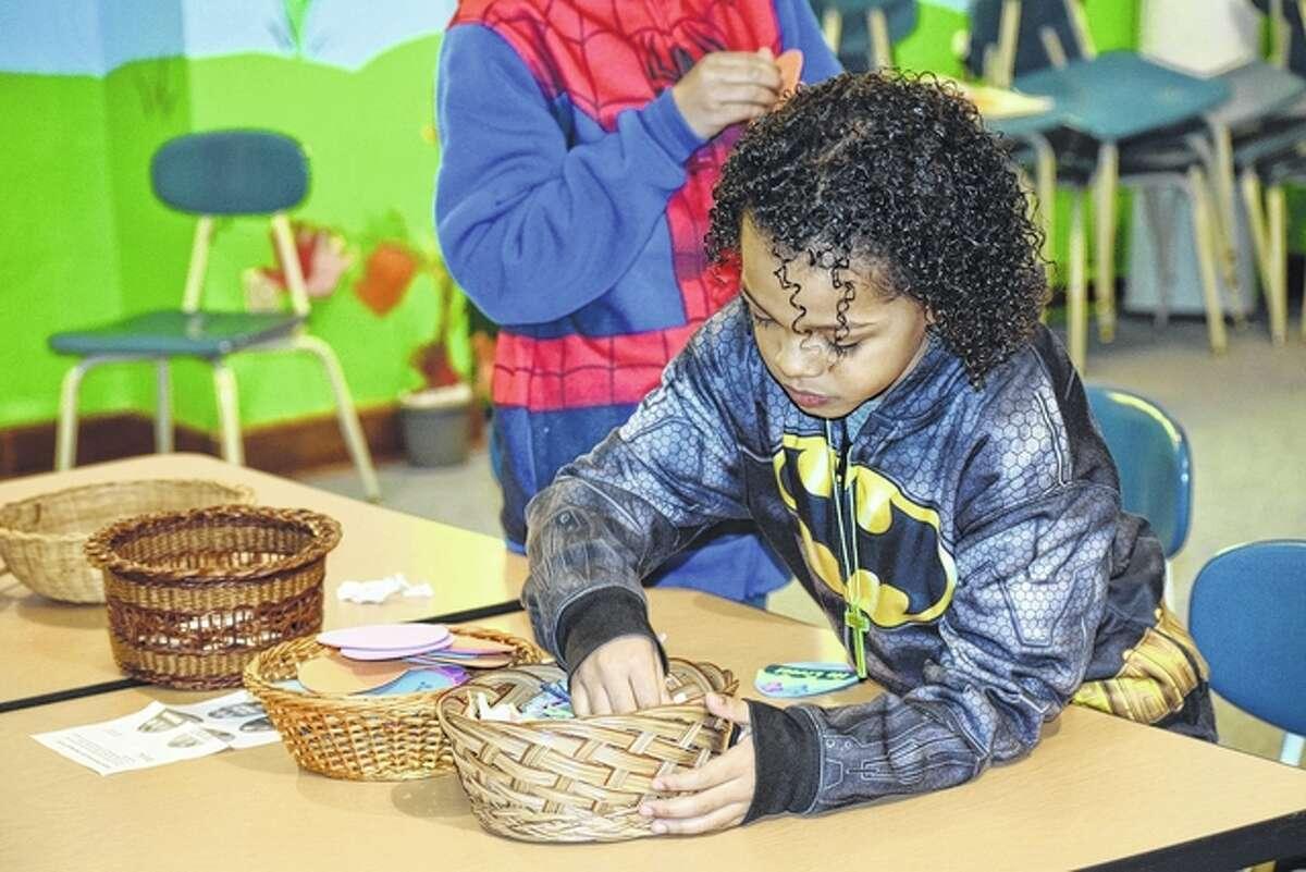 Anthony Winfert, 9, the son of Amanda Aufdenkamp of Jacksonville, creates an Easter egg magnet.