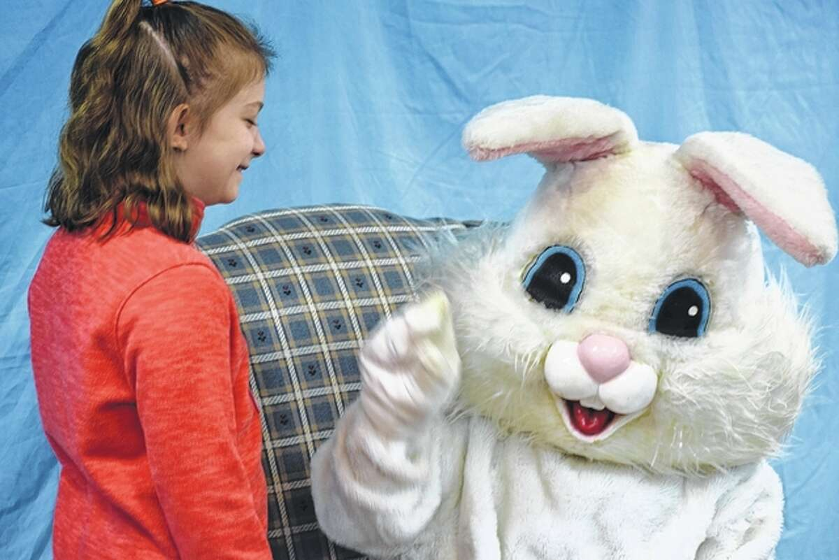 Madeline Nicholson, 9, the daughter of Lindsay and James Nicholson of Jacksonville, talks with the Easter Bunny.