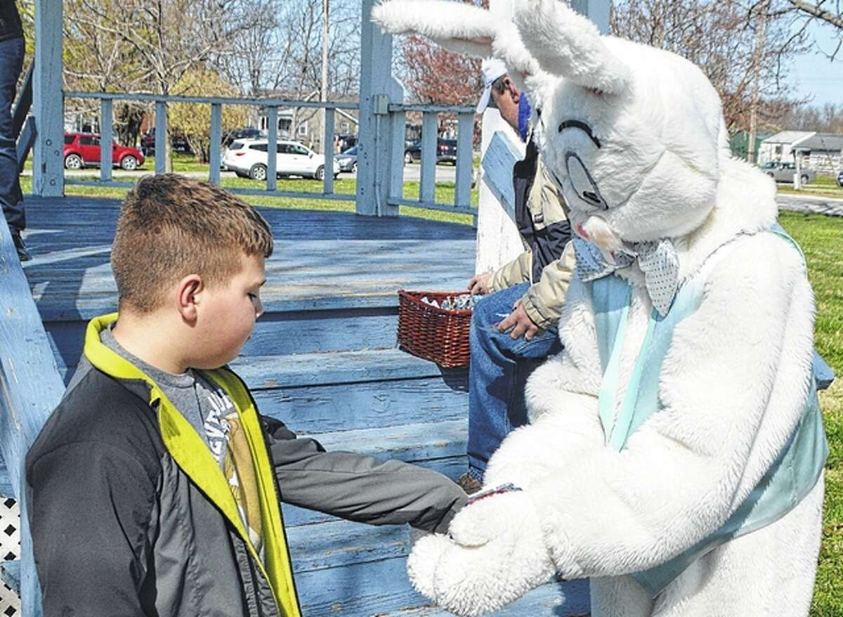 Bryar Buhl of Palmyra receives his prize from the Easter Bunny after completing the annual village Easter egg hunt in Scottville this weekend.