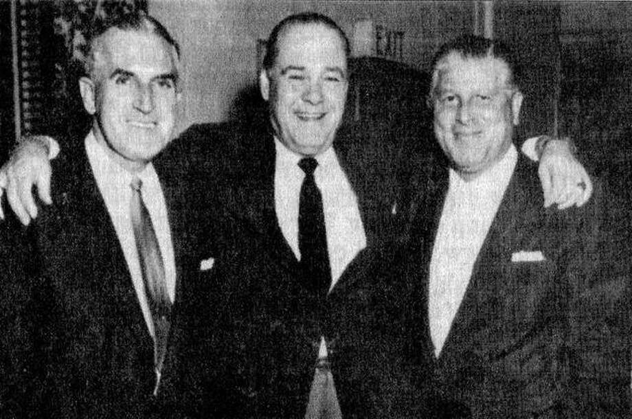 Meredosia native Frank Skinner (1897-1968) stands between two Universal Pictures executives in the 1950s. Skinner made it big on Broadway and in Hollywood as a composer and arranger of music.