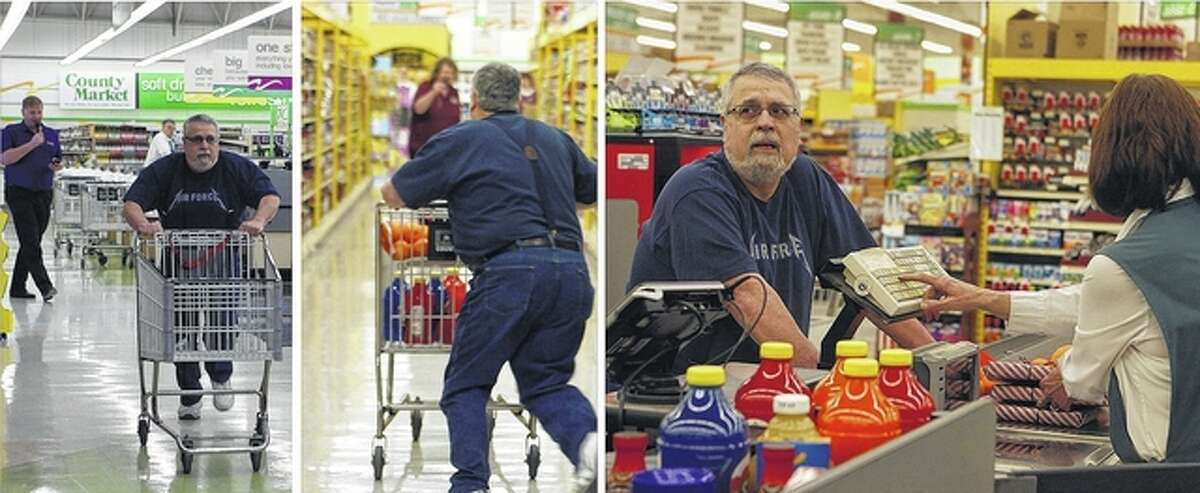 Matt Hollendonner races through County Market to collect as much food as possible in two minutes during the Prairie Council on Aging County Market Sweep. Hollendonner collected food to donate to the Jacksonville Area Community Food Center, the Jacksonville Senior Center and the Presbyterian Church Daycare. He collected $537.14 worth of items.
