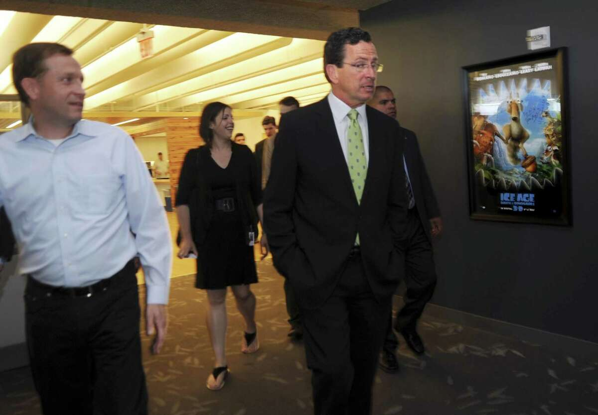 Blue Sky Studios Chief Operating Officer Brian Keane, left, shows Governor Dannel P. Malloy around the company's studios during Malloy's job tour on Monday, June 27, 2011. Photo by Helen Neafsey 6/28/11 GT photo = Talking Jobs. Malloy: Let's remove business obstacles. by Helen Neafsey