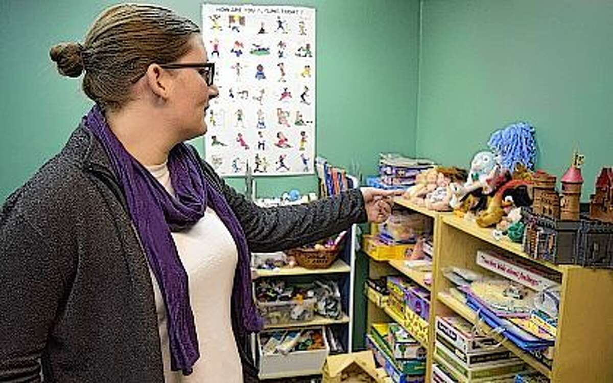 Legal advocate/preventionist Allison Morehead show the children's counseling room at the Prairie Center Against Sexual Assault. The Jacksonville office no longer has child counseling and because of the ongoing state budget impasse has had to discontinue all counseling at the location.