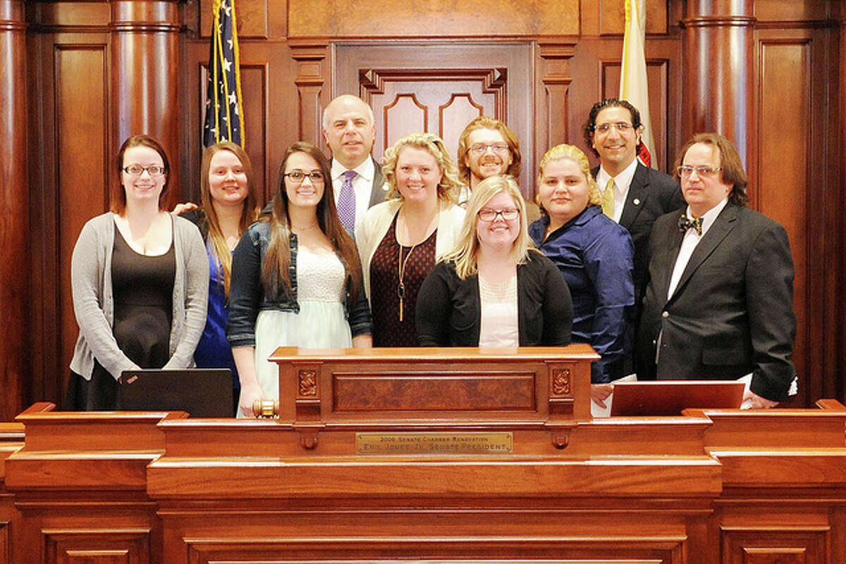Photo provided State Sen. Sam McCann, R-Plainview, meets Thursday with MacMurray College students on the floor of the Illinois Senate.