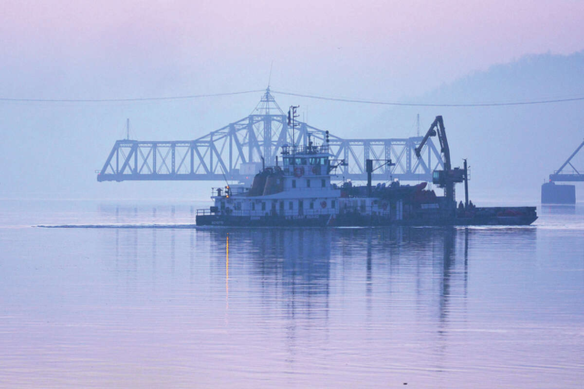 A U.S. Coast Guard barge waits for the train bridge to open on the Mississippi River in Pike County.