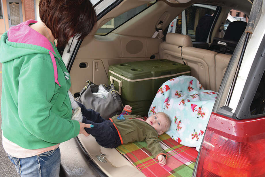 Daniella McDowell prepares to change her 14-month-old son in her car. McDowell is advocating for businesses to install diaper changing stations. Photo: Samantha McDaniel-Ogletree | Journal-Courier