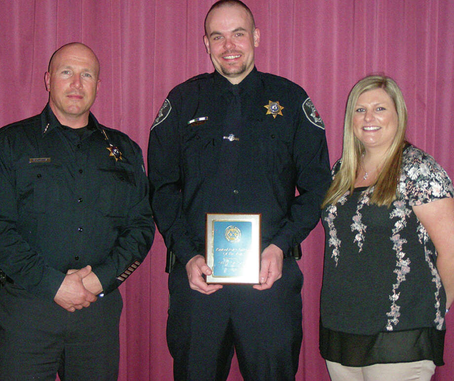 Dave Hinton | Rantoul Press Kevin Gregg (center), who was named Rantoul Police Officer of the Year at last week's Rantoul Exchange Club, accepts the award with Police Chief Erman Blevins and Gregg's fiancee, Emily Benting.