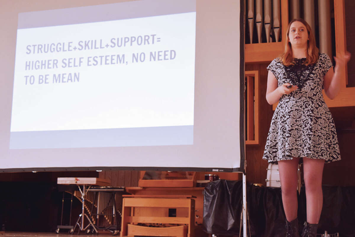 Valerie Weisler speaks Monday at Illinois College about her organization, The Validation Project. Weisler started it to provide support for teenagers.