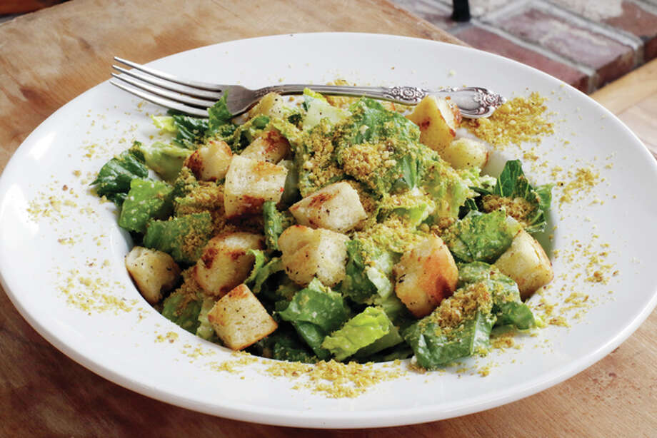 Vegan Caesar salad combines Japanese miso paste and nutritional yeast flakes to mimic the rich, savory flavor this dish usually gets from anchovies and Parmesan cheese. Photo: J.M. Hirsch | Associated Press
