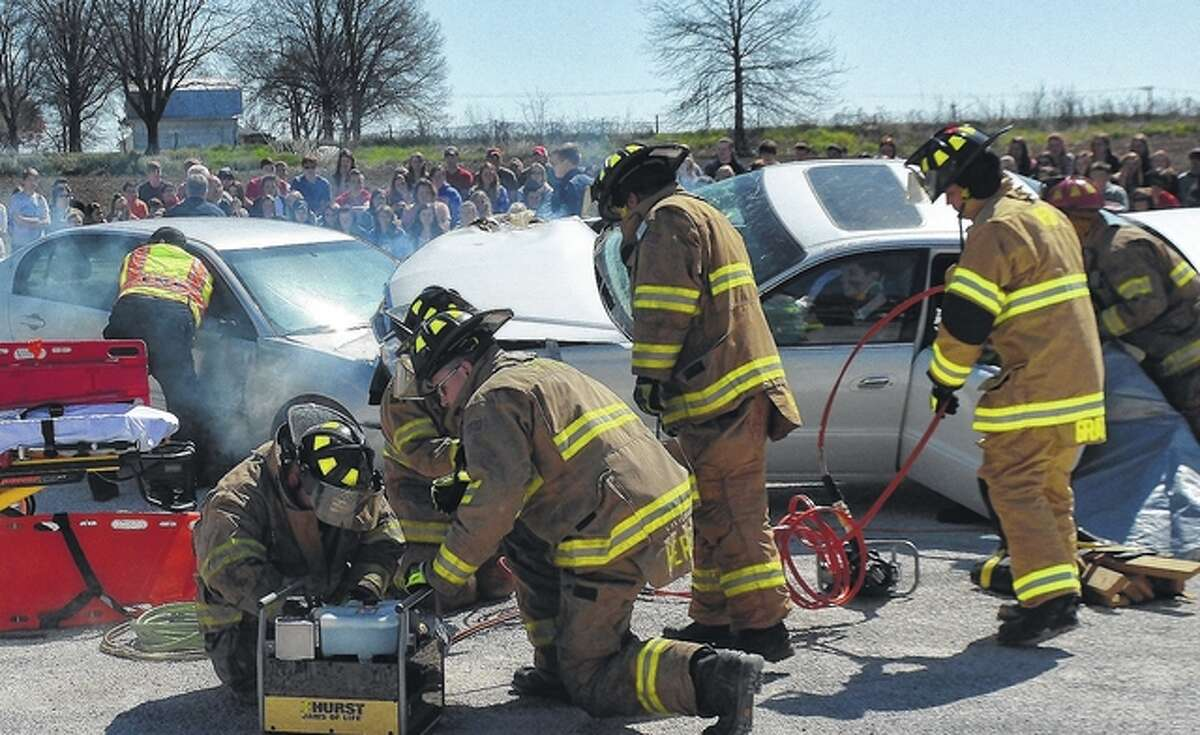 Jeff Ruzicka | Journal-Courier Pittsfield Fire Department members use a training session to show students what happens when they respond to a traffic accident.