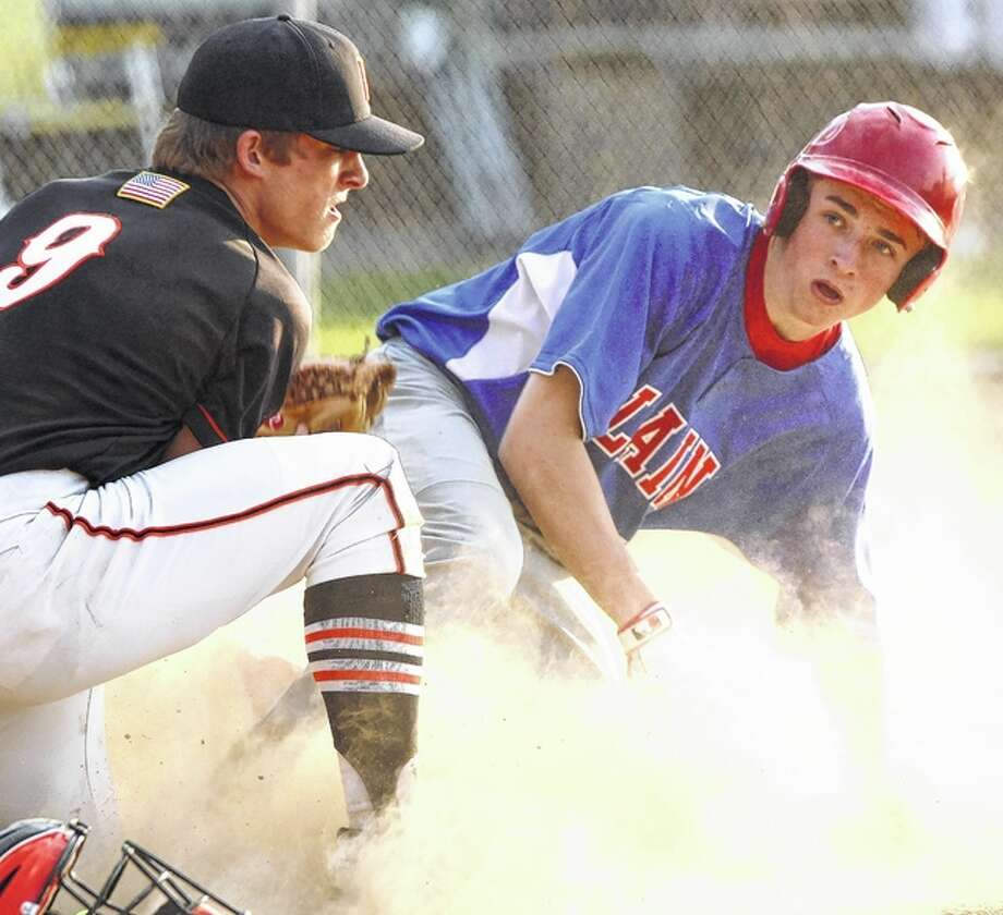 Beardstown pitcher Alec Taylor tags out a Pleasant Plains runner at home plate during the 10th inning of a game in Beardstown Friday afternoon. Photo: Dennis Mathes | Journal-Courier