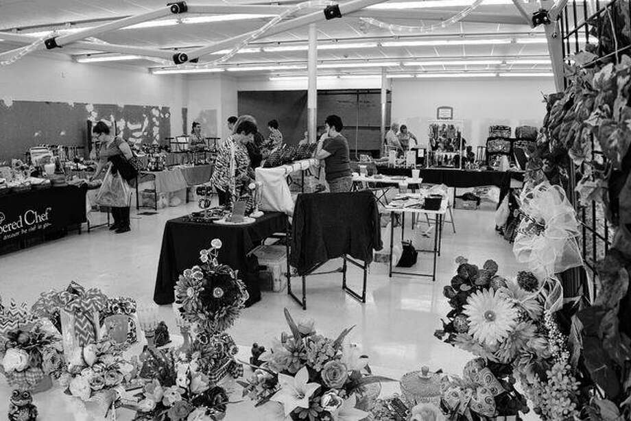 Thirty-four vendors participated in Saturday's Journal-Courier Community Showcase Craft & Business Expo in the former Save-A-Lot store building in Lincoln Square Shopping Center. There were people selling Tupperware, soap, ceramics, florals, kitchen utensils, Avon products and jewelry, to name a few things. In the foreground are silk flower arrangements and wreaths by Memories of Margie, which was created by Payton Bartholomew of Jacksonville in memory of her paternal grandmother, Marge Bartholomew, a former Arenzville resident. Photo: Greg Olson | Journal-Courier