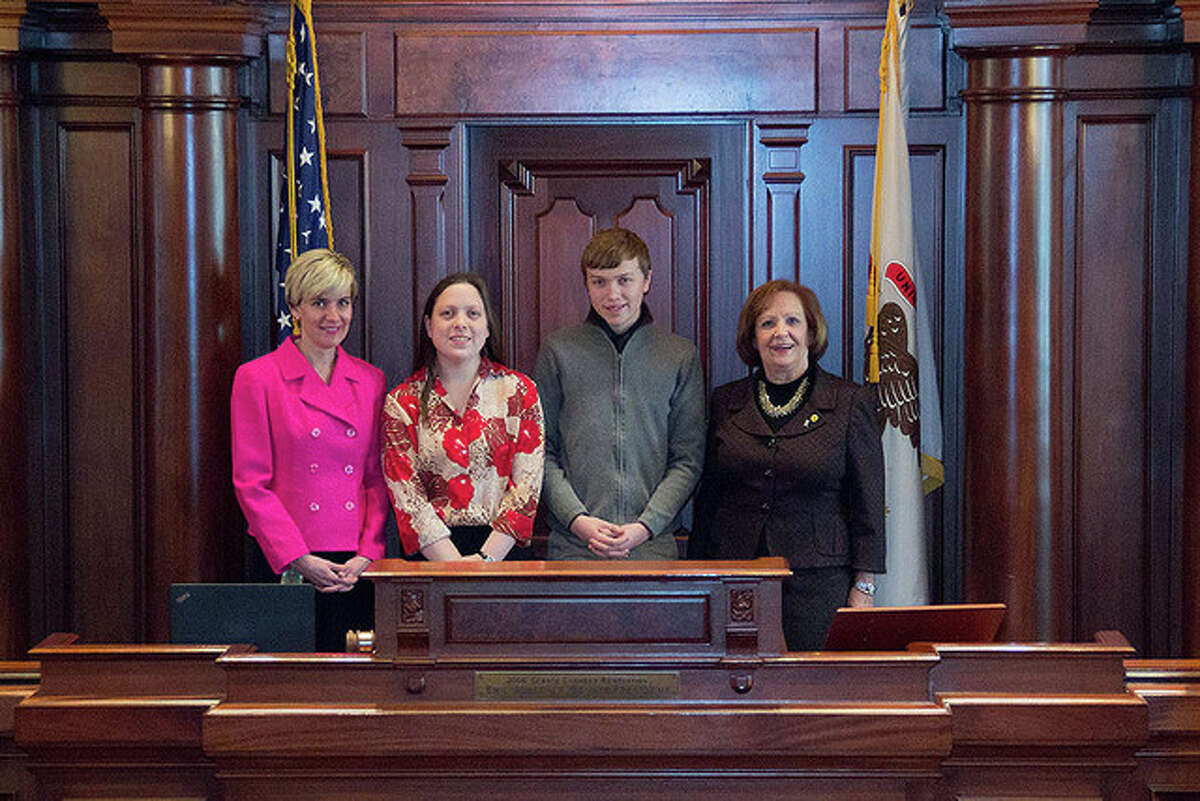 Photo provided During the Illinois Electric and Telephone Cooperatives Youth Day, state representatives Sara Wojcicki Jimenez (left) and Norine Hammond (right) met with Phillip Wessel and Rhiannon Sanford, representatives of Menard Electric Cooperative.