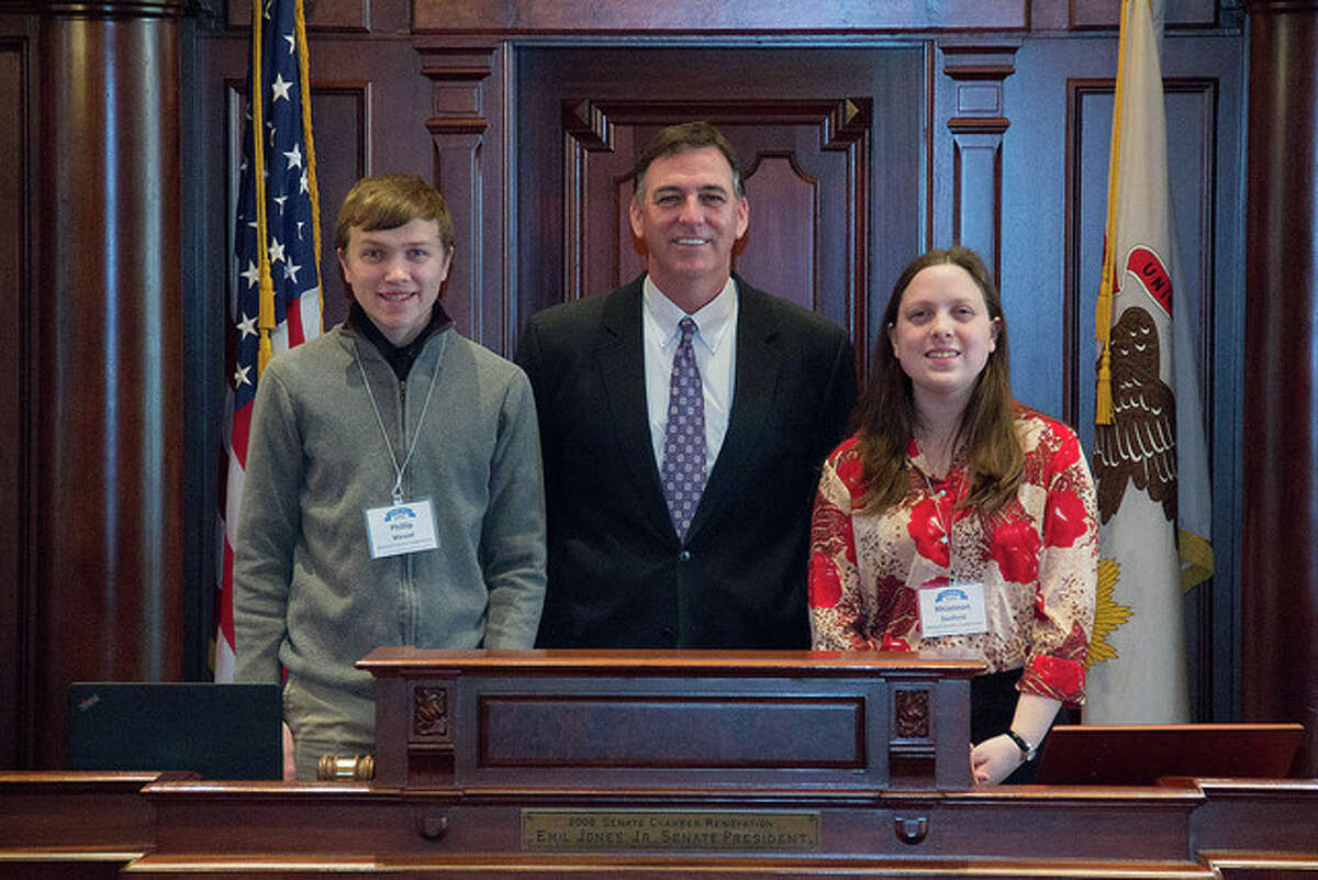 Photo provided Sen. John Sullivan (center) met with Phillip Wessel and Rhiannon Sanford, two students representing Menard Electric Cooperative, during the Illinois Electric and Telephone Cooperatives Youth Day.