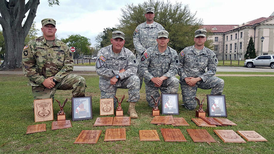 Photo provided Sgt. 1st Class David Perdew (from left) of Rushville, Sgt. 1st Class Shelby Stockton of Petersburg, Chief Warrant Officer 2 Kyle Gleason of Lincoln, Staff Sgt. Jacob Blount of St. Louis and Staff Sgt. Brian Hornung of Mendota display the awards they won during a national shooting competition involving about 200 soldiers.