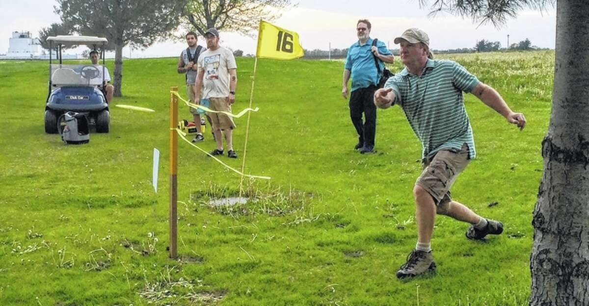 Todd Birdsell of Jacksonville tees off on hole 17 Sunday at Northridge Hills Golf Course in Jacksonville during the final round of the Huck in the Hills disc golf tournament. The tournament was organized by the Jacksonville Disc Golf Club.