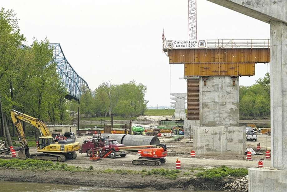 Nine concrete piers are being constructed for the new Illinois Route 104 bridge over the Illinois River at Meredosia. At left is the 1936 bridge, which will be demolished once the new bridge is completed in about two and a half years. Photo: Greg Olson | Journal-Courier