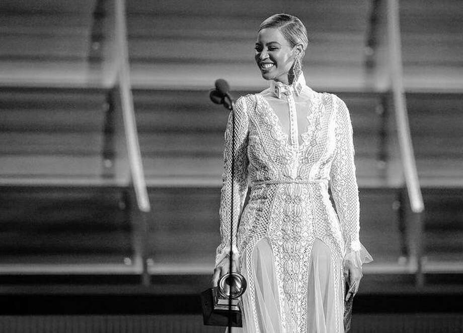"""In this Feb. 15 file photo, Beyoncé presents the award for record of the year at the 58th annual Grammy Awards in Los Angeles. After the recent debut of her visual album """"Lemonade"""" on HBO, a Ticketmaster representative told The Associated Press on Wednesday that the ticket outlet company saw searches for Beyoncé's concerts increased by 116 percent compared to last week. Matt Sayles 