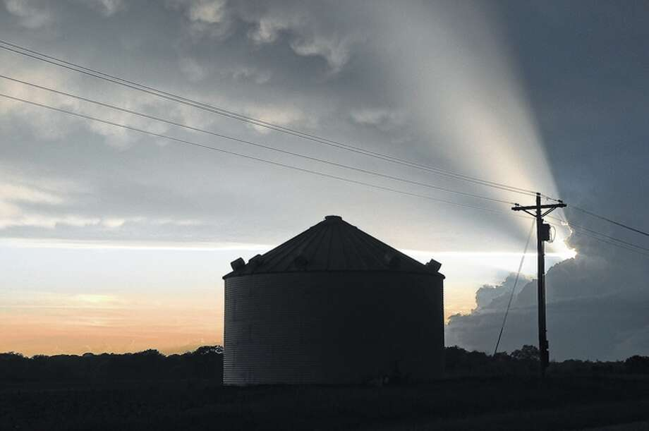 A last beam of sunshine breaks through the evening clouds over a farm near the Morgan and Greene counties line.