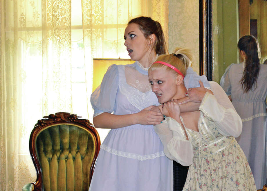 """Mackenzie Musch (left) and Ally Bunfill rehearse a scene from the latest Ken Bradbury play, """"A Trip Through Time."""" The production will benefit Jacksonville's Daughters of the American Revolution chapter, which works to maintain the Gov. Duncan Mansion. Photo: Submitted Photo"""