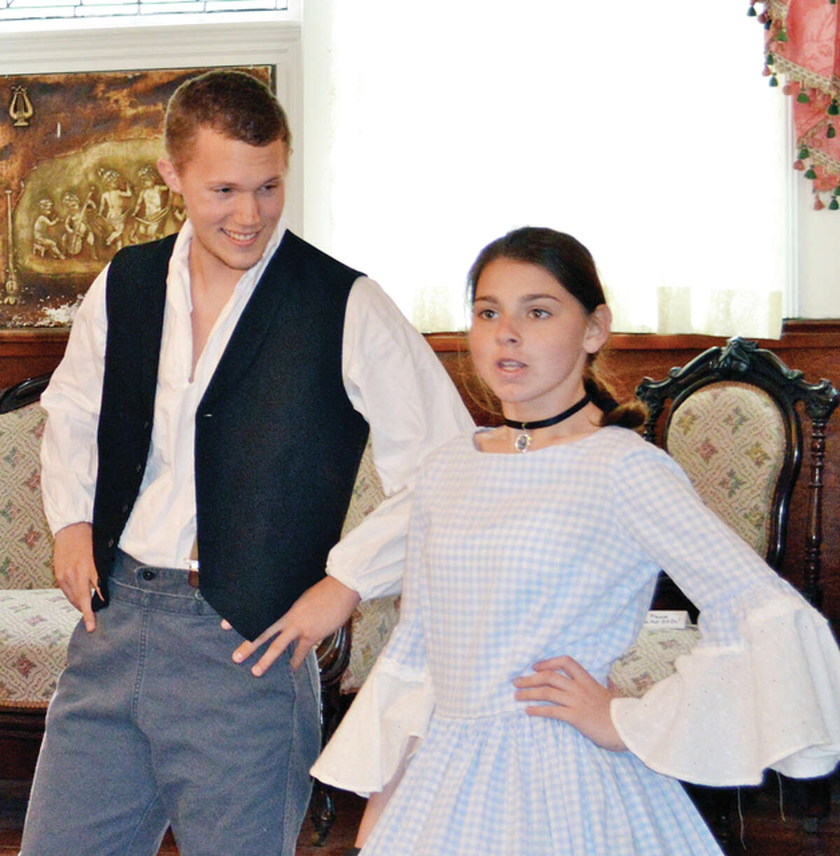 """Brenan Pool (left) and Abby Link rehearse a scene from """"A Trip Through Time."""""""