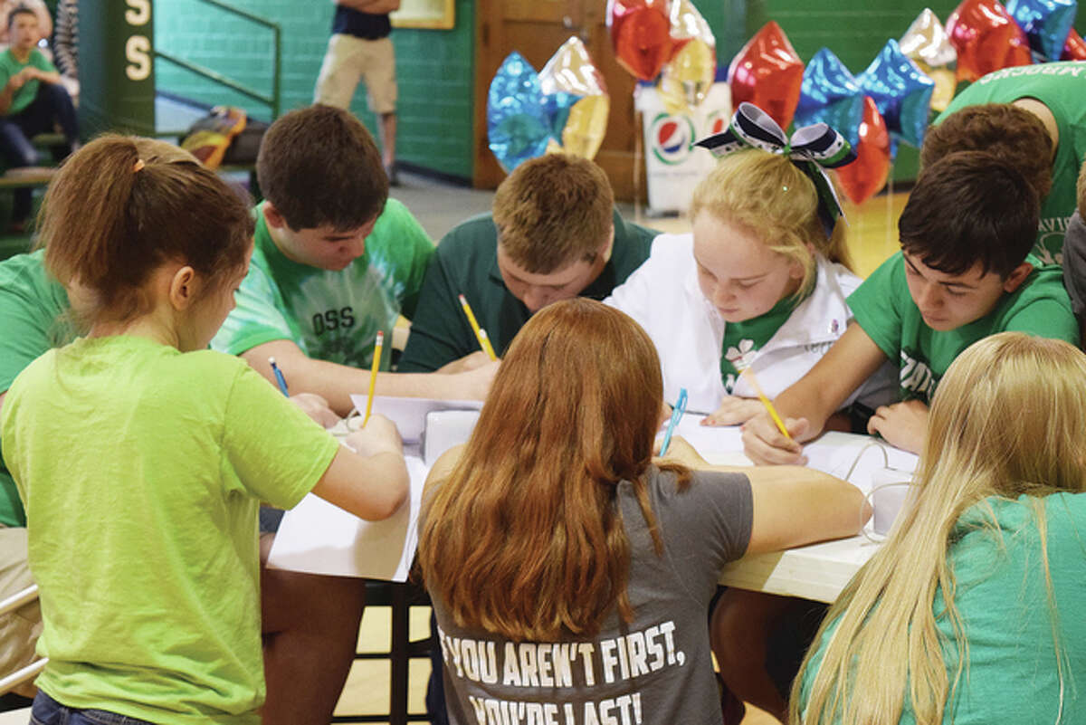 Members of the Our Saviour School Scholastic Bowl teams prepare to challenge a team of teachers during a mock game Thursday before the students go to the state finals today in Peoria.