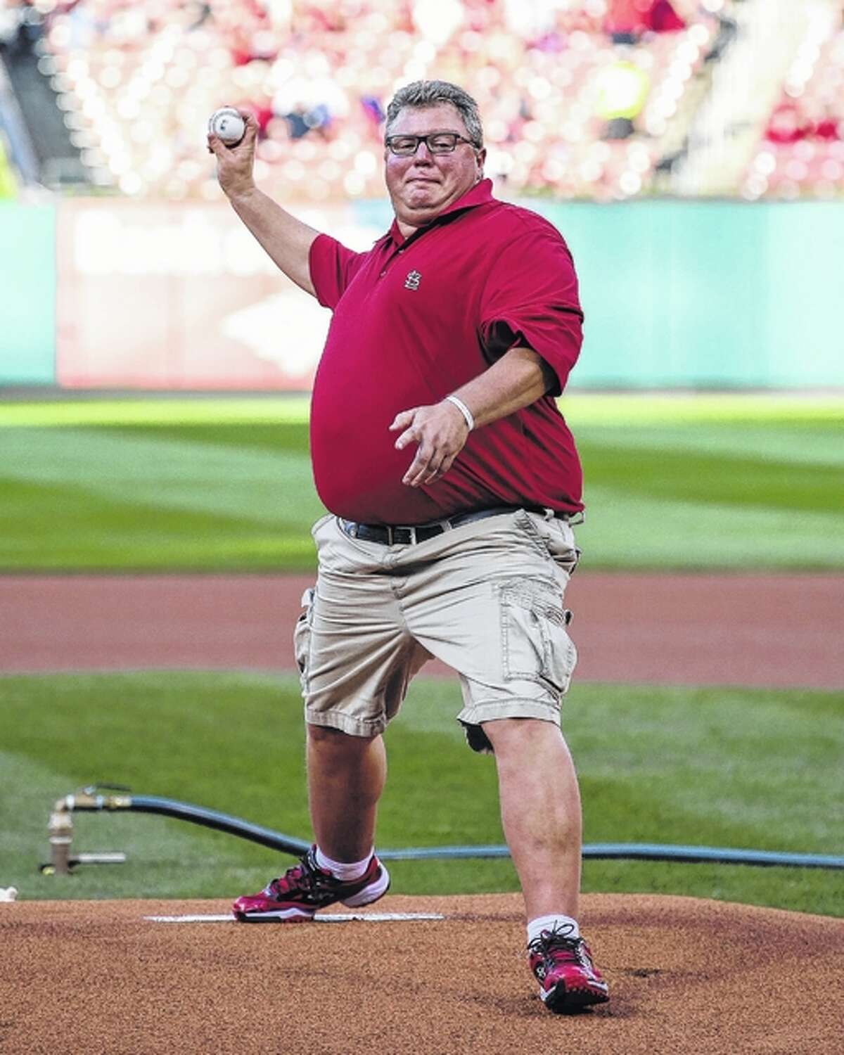 Jacksonville Mayor Andy Ezard throws out the first pitch before Friday night's game between the Pittsburgh Pirates and the St. Louis Cardinals at Busch Stadium in St. Louis. (Photo by Tim Spyers)