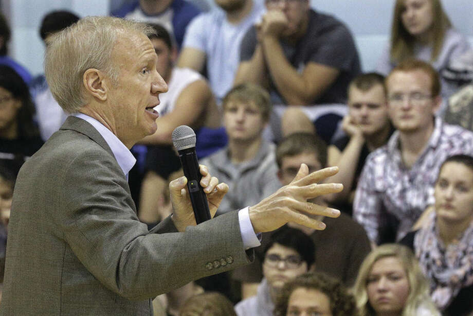 Seth Perlman | AP Gov. Bruce Rauner speaks to students and answer questions last month while visiting Auburn High School. Rauner and others said Monday there is some progress being made in an ongoing state budget impasse.