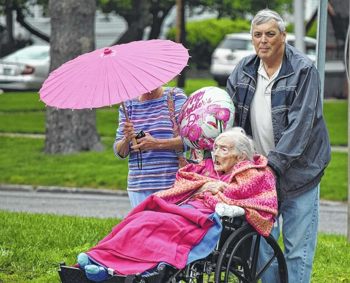 Lena Briggs, who is 101 years old, leads the National Nursing Home Week parade Monday at Heritage Health Therapy & Senior Care in Jacksonville. Briggs was accompanied by her son, Bill Briggs, and daughter, Shelby Pennel.