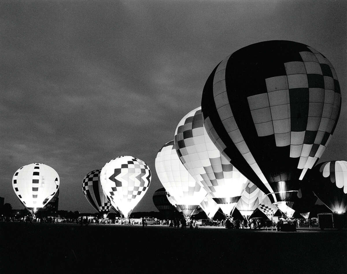 Traditional black and white photos by Tim Schroll, such as this image of a hot-air balloon glow, will be among the art featured during May at the Art Association of Jacksonville's David Strawn Art Gallery.
