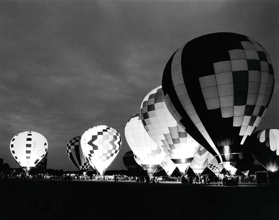 Traditional black and white photos by Tim Schroll, such as this image of a hot-air balloon glow, will be among the art featured during May at the Art Association of Jacksonville's David Strawn Art Gallery. Photo: Submitted Photo