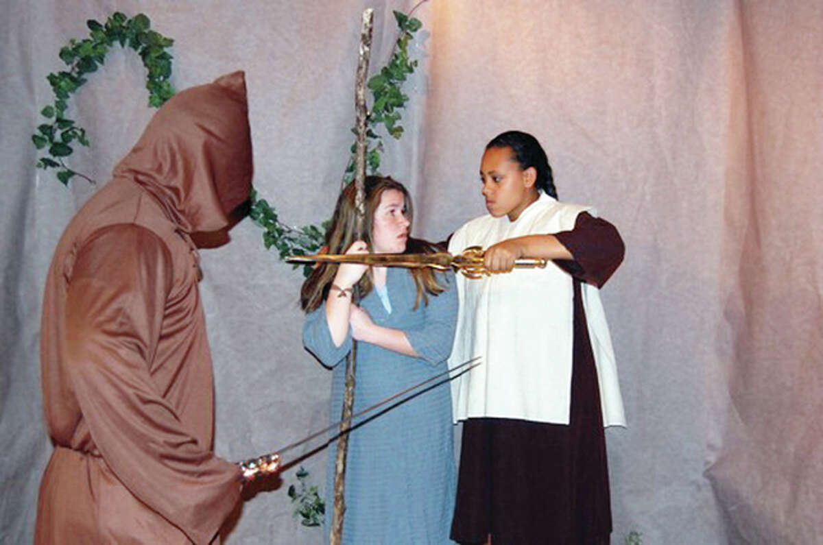 """Cole Burke (from left), Maeve Hollahan and Miriam Wali-Udinn rehearse a scene from """"The Chasm"""" at Routt Catholic High School. A performance of the play will be part of Routt's 2016 Spring Fine Arts Extravaganza, which will be Friday night at the school."""
