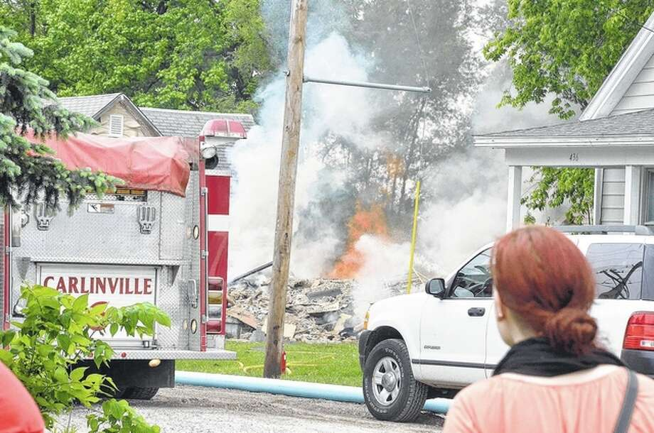 A house exploded Wednesday in the 400 block of West North Street in Carlinville, injuring several people. It is believed the explosion was caused by a natural gas leak. Photo: Eric Becker | Macoupin County Enquirer-Democrat