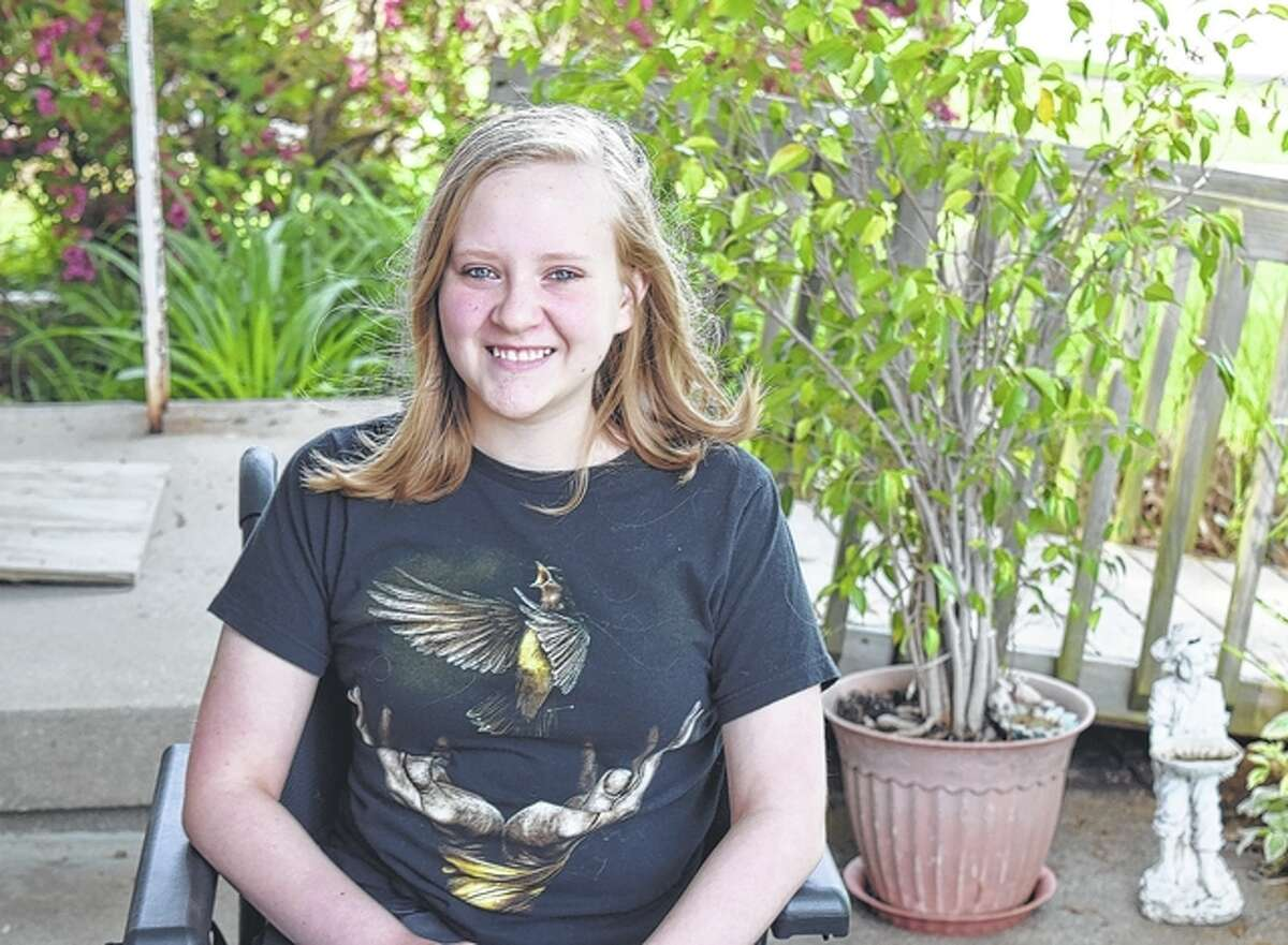 Lizzie Chamberlain, 13, is part of an online competition that would allow her to win a handicapped-accessible van.