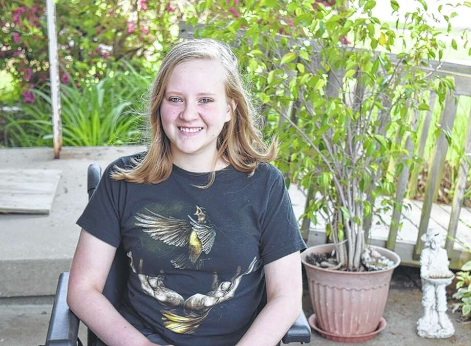 Lizzie Chamberlain, 13, is part of an online competition that would allow her to win a handicapped-accessible van. Photo: Samantha McDaniel-Ogletree | Journal-Courier