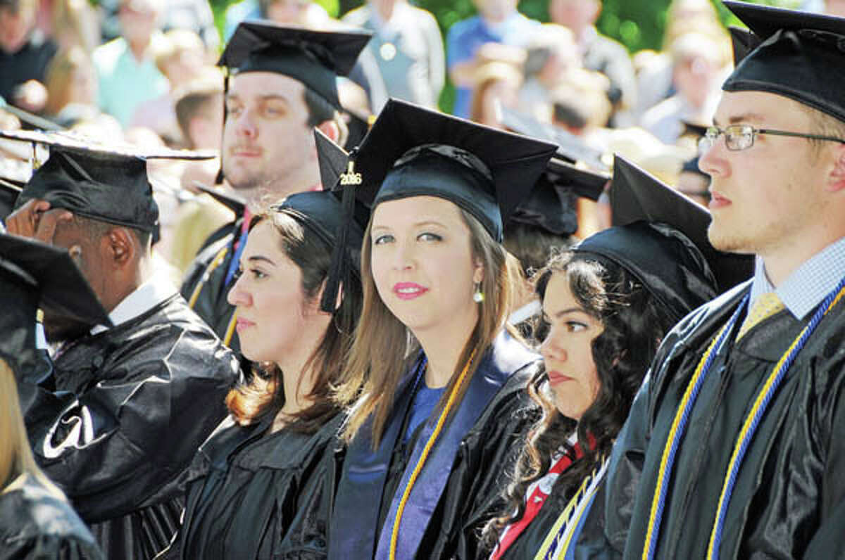 Megan Prough of Carrollton smiles Sunday while waiting with her fellow Illinois College graduates to receive her diploma.