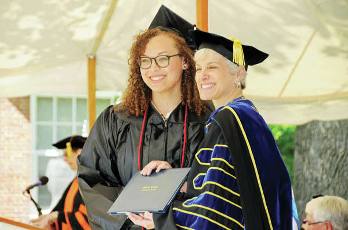 Alexia Helmer of Jacksonville receives her diploma from IC President Barbara Farley.