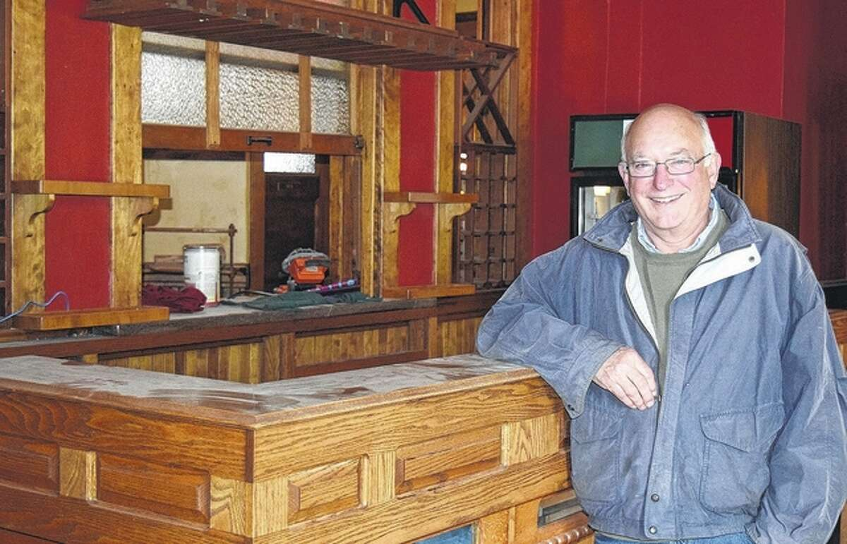 Frank Whitney of Jacksonville, one of the new co-owners of Lonzerotti's Italia Restaurant, stands in the restaurant's bar area. Lonzerotti's is set to reopen June 10 after being closed for more than four months.