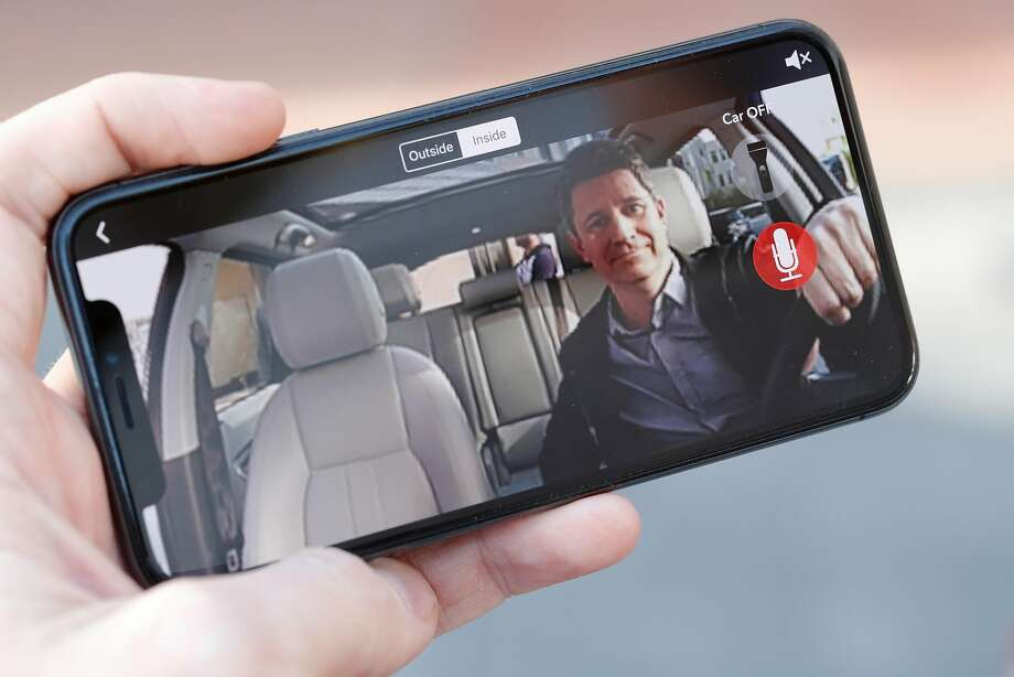 Owl Cam CEO Andy Hodge visible on a smart phone displaying the video feed of an Owl car security cam mounted in a company vehicle at their headquarters in Palo Alto, Calif., on Thursday, February 8, 2018. Palo Alto startup Owl has created a car security camera, placed on the dashboard, with cameras facing forward and backward, to automatically record any incident involving the car. This includes break-ins, crashes, parking lot dings. Photo: Carlos Avila Gonzalez, The Chronicle