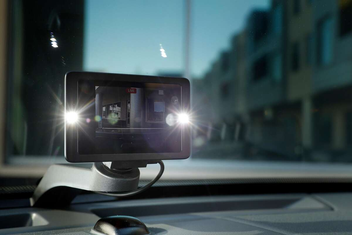 The Owl car security camera mounted in a company vehicle with it's LED lights enabled at their headquarters in Palo Alto, Calif., on Thursday, February 8, 2018. Palo Alto startup Owl has created a car security camera, placed on the dashboard, with cameras facing forward and backward, to automatically record any incident involving the car. This includes break-ins, crashes, parking lot dings.