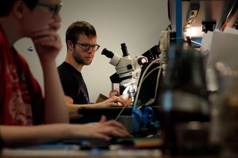 Electrical engineer Ben Petroski checks a wiring diagram before working on a circuit board at the headquarters of Palo Alto startup Owl Cameras. Photo: Carlos Avila Gonzalez, The Chronicle