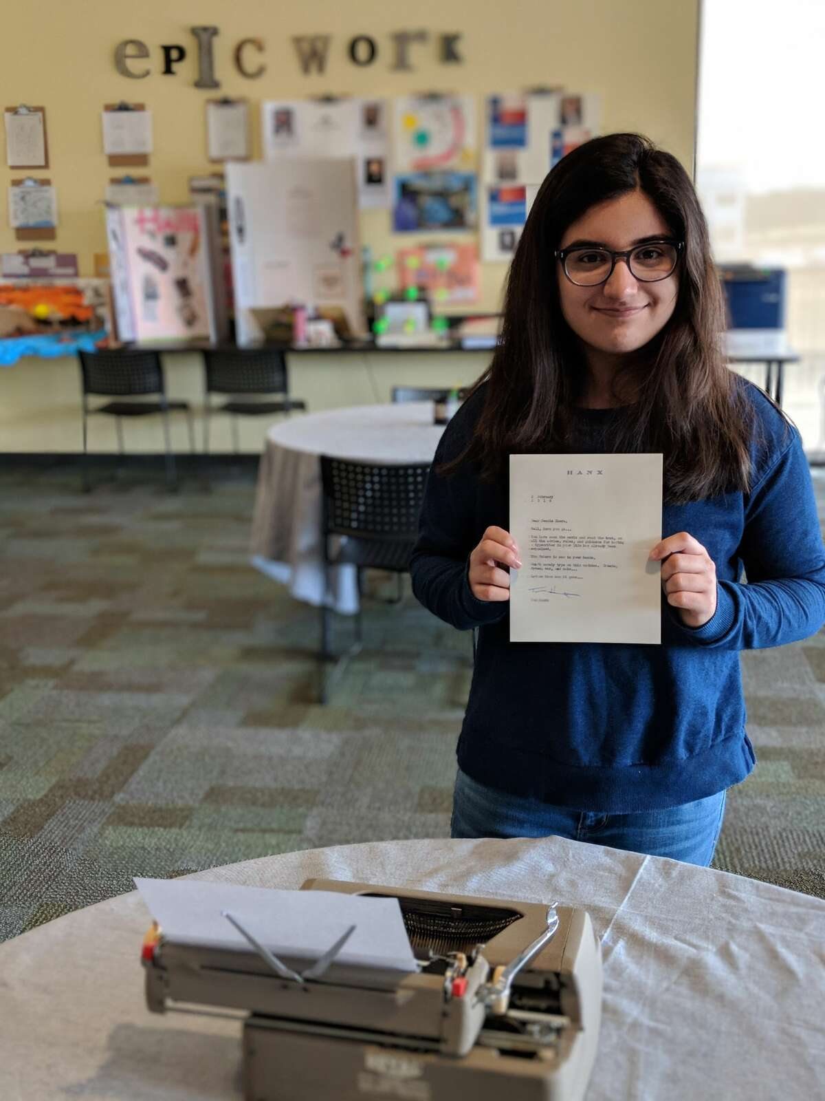 Jessica Khera, 15, holds a letter from Tom Hanks, next to the typewriter he sent her. Khera said she was inspired to reach out to Hanks after reading his book