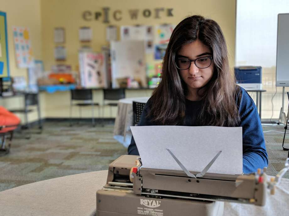 "Jessica Khera, 15, types on a Royal typewriter that Tom Hanks sent her. Khera said she was inspired to reach out to Hanks after reading his book ""Uncommon Type,"" a book of short stories written by the actor. Photo: Ahmad Hernandez, Ahmad Hernandez"