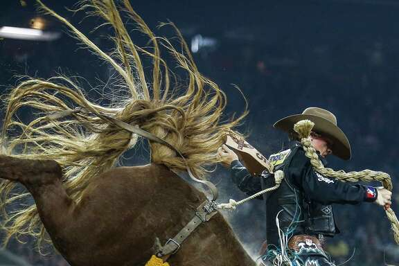 Saddle bronc rider Ryder Wright bucks on the back of his horse, Umber Bubbles, during round three of Super Series III at the Houston Livestock Show and Rodeo Wednesday, March 15, 2017 in Houston. Wright placed fourth with a score of 83. ( Michael Ciaglo / Houston Chronicle )